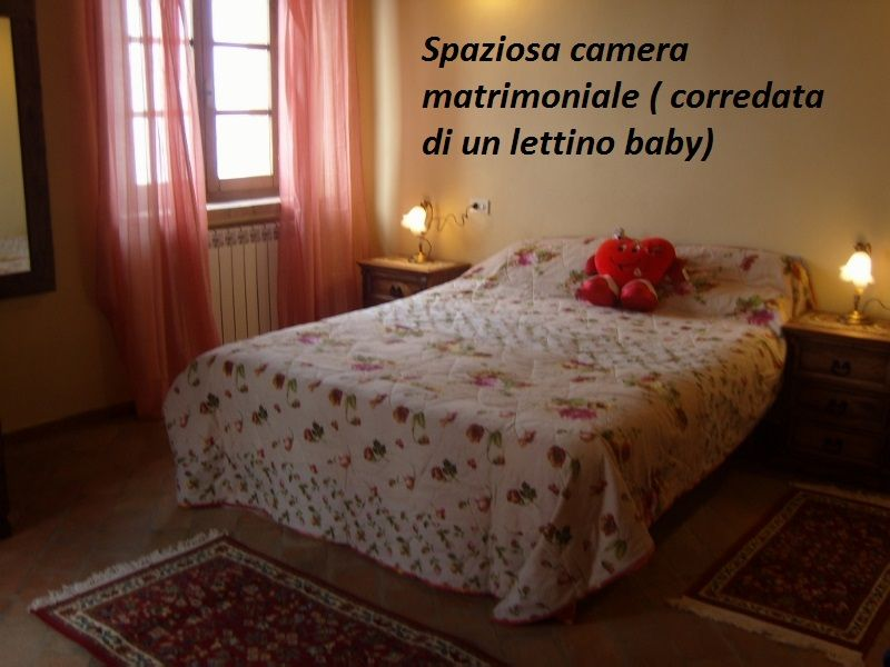 slaapkamer 1  Huis 87280 Cortona